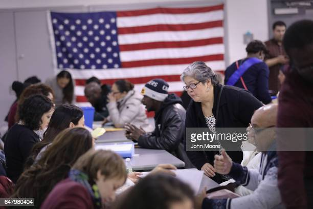Immigrants receive assistance to complete their U.S. Citizenship applications during a Citizenship Now! event held in the Bronx on March 4, 2017 in...