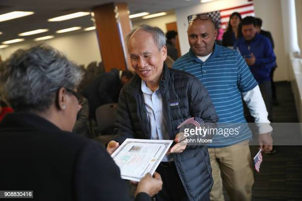 Immigrants receive US citizenship certificates following a naturalization service on January 22 2018 in Newark New Jersey Although much of the...