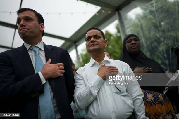 Immigrants recite the Pledge of Allegiance during a naturalization ceremony at Franklin D Roosevelt Four Freedoms Park on Roosevelt Island June 16...