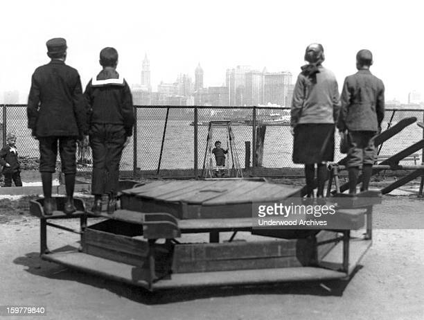 Immigrants representing four countries Poland Norway Germany and Russia looking from Ellis Island towards the promised land New York New York c 1913