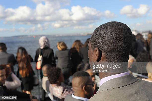 Immigrants ride in a ferry to Ellis Island for a naturalization ceremony on September 16 2016 in New York City The ceremony marked US Constitution...