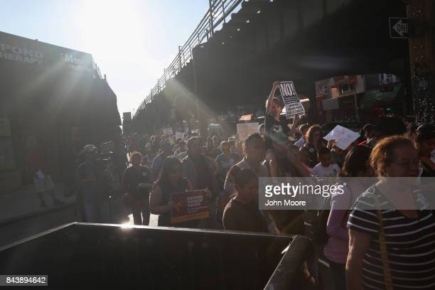 Immigrants' rights demonstrators march in protest of President Trump's decision on DACA on September 7 2017 in the Queens borough of New York City...
