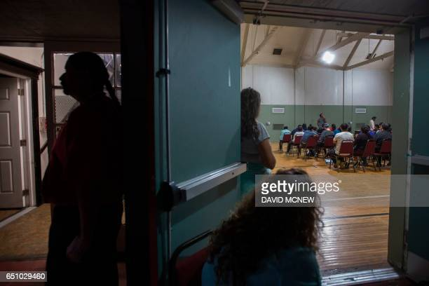 Immigrants take a workshop to make a preparedness plan in case they are confronted by immigration officials at Academia Avance charter school where...