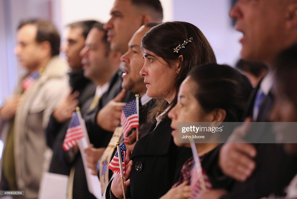 Immigrants take oath of citizenship to the United States on November 20, 2014 in Newark, New Jersey. Sixty immigrants from 25 countries became American citizens during the naturalization ceremony at the U.S. Immigration and Citizenship Services (USCIS) office at Newark's Federal Building.