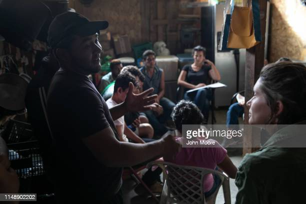 Immigrants take part in an educational session on US political asylum organized by American activists while at an immigrant shelter on May 09 2019 in...