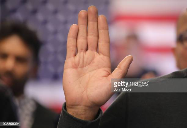 Immigrants take the oath of allegiance to the United States at a naturalization ceremony on January 22 2018 in Newark New Jersey Immigrants from 32...
