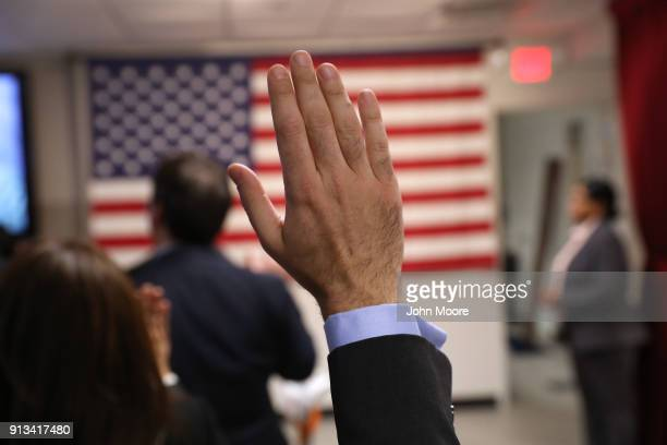 Immigrants take the oath of allegiance to the United States at a naturalization ceremony on February 2 2018 in New York City US Citizenship and...