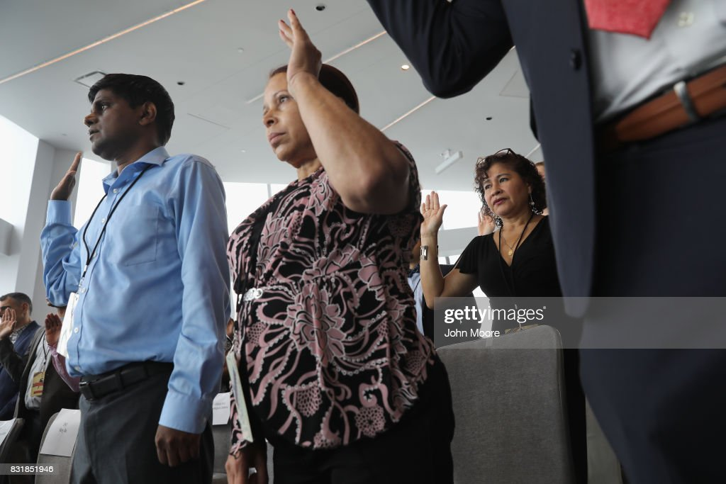 Immigrants take the oath of allegiance to the United States