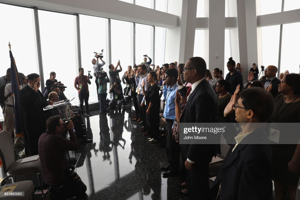 Immigrants take the oath of allegiance to the United States at a naturalization ceremony held in the observatory of the One World Trade Center on August 15, 2017 in New York City. Thirty immigrants took the oath of citizenship to become American citizens at One World Trade, which at 1,776 feet high is the tallest building in the Western Hemishere.