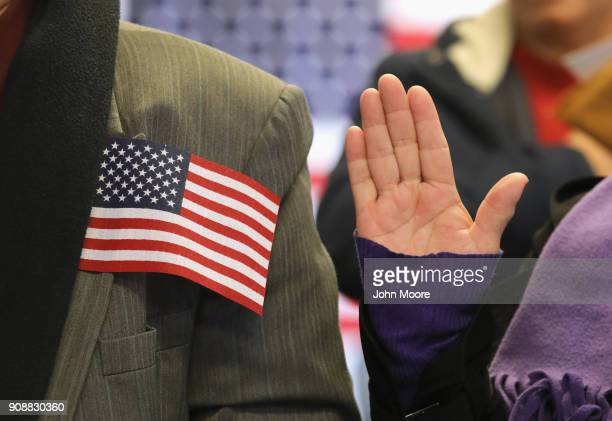 Immigrants take the oath of citizenship to the United States at a naturalization service on January 22 2018 in Newark New Jersey Although much of the...