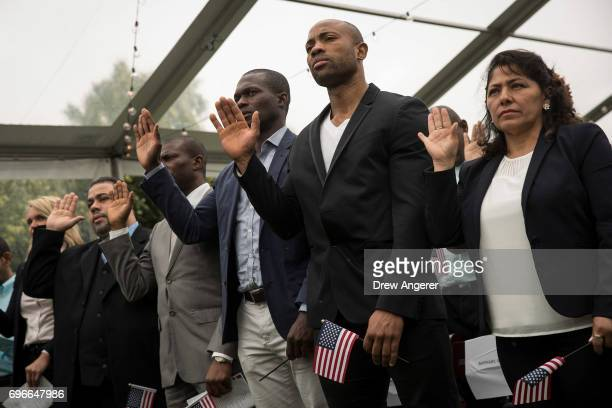 Immigrants take the oath of citizenship to the United States during a naturalization ceremony at Franklin D Roosevelt Four Freedoms Park on Roosevelt...