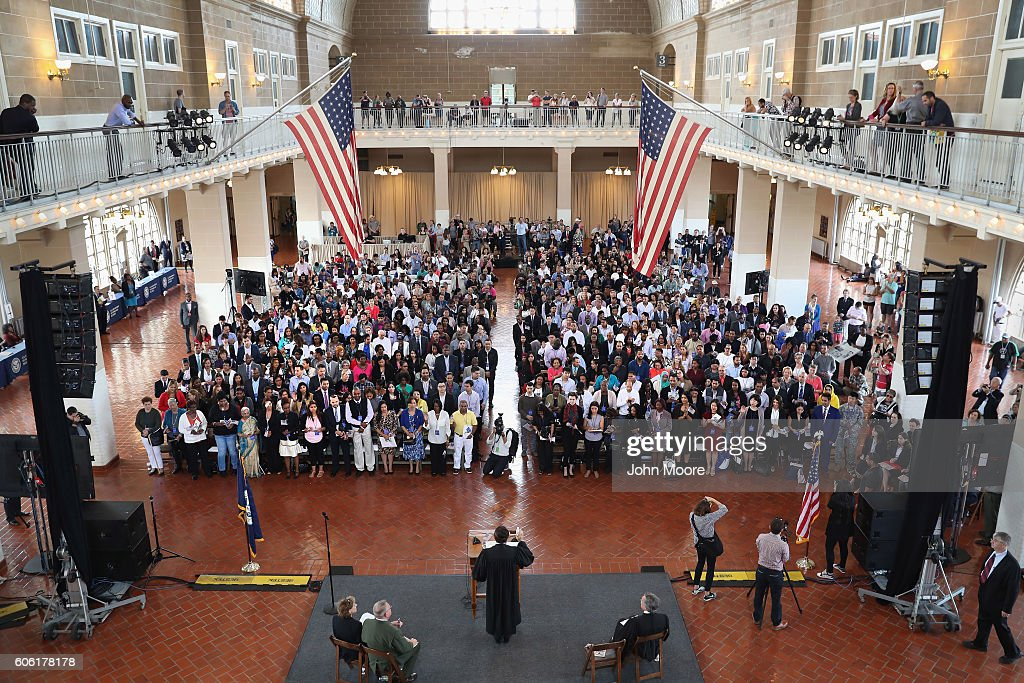 Immigrants take the oath of citizenship to the United States in the Great Hall of Ellis Island on September 16, 2016 in New York City. Robert Katzmann, Chief Judge, U.S. Court of Appeals for the Second Circuit administered the oath to mark Constitution and Citizenship Day. According to U.S. Citizenship and Immigration Services (USCIS), some 38,000 people nationwide are becoming American citizens in 240 ceremonies nationwide this week, the most of any week in 2016.