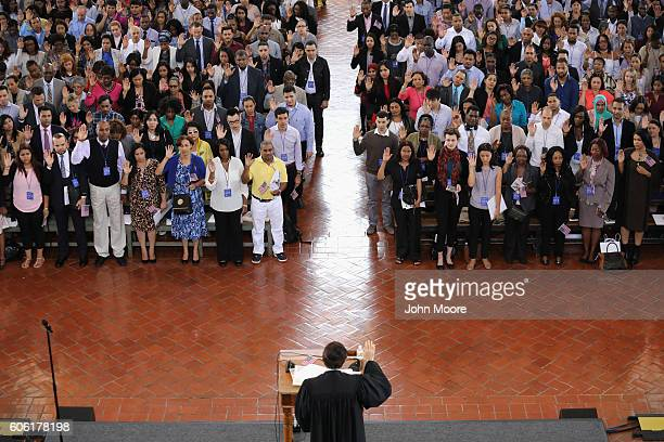 Immigrants take the oath of citizenship to the United States in the Great Hall of Ellis Island on September 16, 2016 in New York City. Robert...