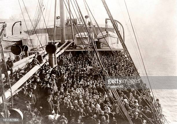 Immigrants to the United States on the deck of the SS Patricia, originally of the Hamburg-American Line, 10th December 1906. This image is from the...