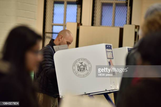 Immigrants voters cast their ballots on Election Day at PS 69 on November 06 2018 in the Jackson Heights neighborhood of the Queens borough of New...