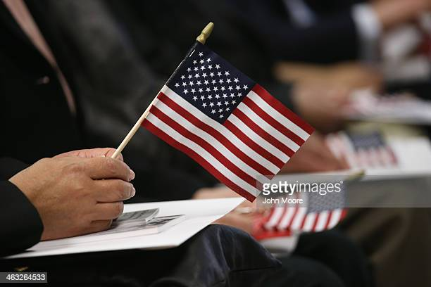 Immigrants wait for a naturalization ceremony held at the US Citizenship and Immigration Services office on January 17 2014 in New York City One...