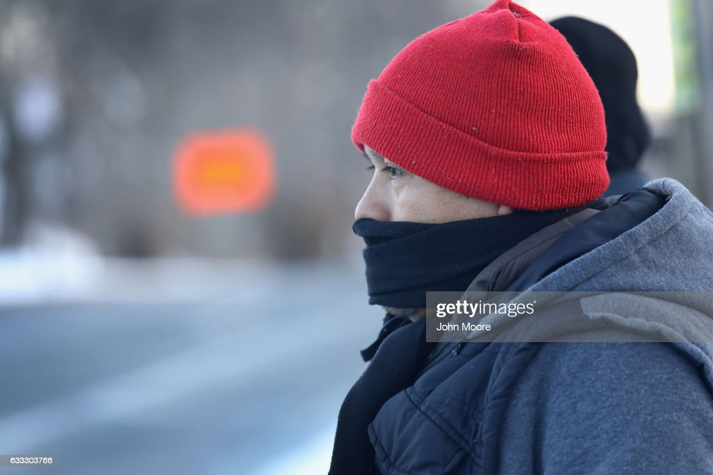 Immigrants wait for work as day laborers on February 1, 2017 in Stamford, Connecticut. The city of Stamford has an official zone for employers to pick up day laborers, although many prefer to stand by nearby businesses for warmth and greater visibility to employers. Stamford, CT is located in Fairfield County, considered a 'sanctuary county' for not reporting undocumented immigrants to federal authorities.