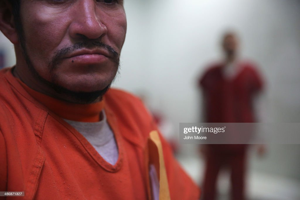 Immigrants wait in a processing cell at the Adelanto Detention Facility on November 15, 2013 in Adelanto, California. The center, the largest and newest Immigration and Customs Enforcement (ICE), detention facility in California, houses an average of 1,100 immigrants in custody pending a decision in their immigration cases or awaiting deportation. The facility is managed by the private GEO Group. ICE detains an average of 33,000 undocumented immigrants in more than 400 facilities nationwide.