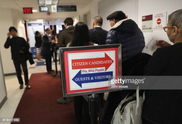 Immigrants wait in line to become US citizens at a naturalization ceremony on February 2 2018 in New York City US Citizenship and Immigration...