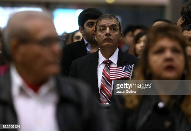 Immigrants wait to be sworn in as US citizens during a naturalization ceremony held by US Citizenship and Immigration Services at the Los Angeles...