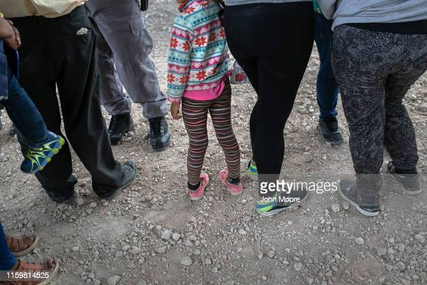 Immigrants wait to be transported to a McAllen processing center after they were taken into custody by US Border Patrol agents on July 02 2019 in...