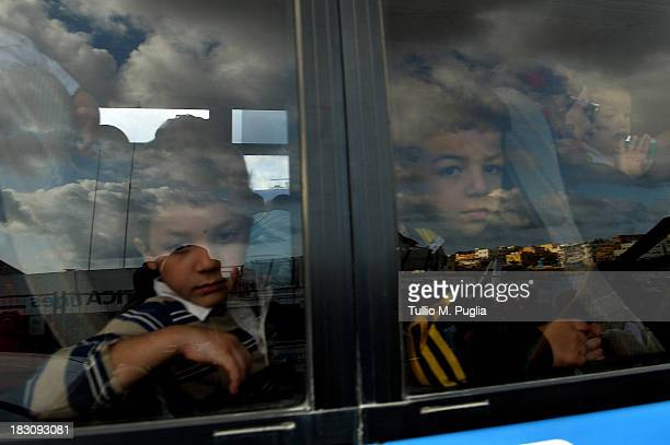 Immigrants wait to board a ship bound for Porto Empedocle Sicily on October 4 2013 in Lampedusa Italy The search for bodies continues off the coast...