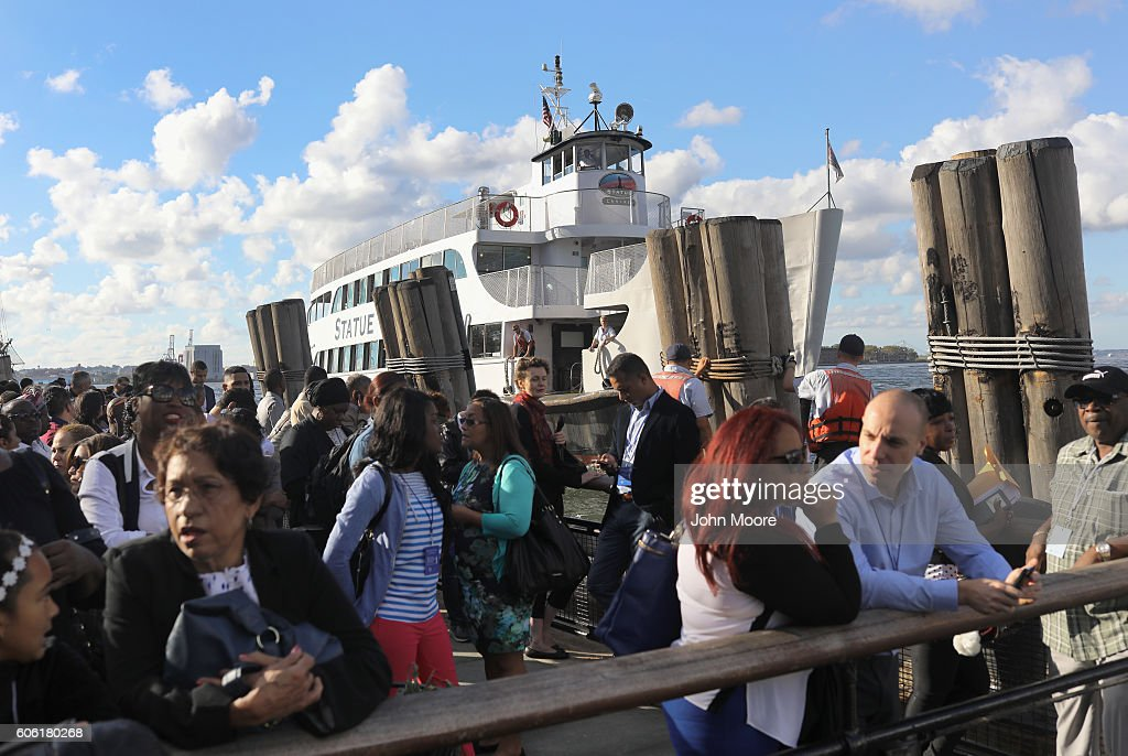 Immigrants wait to ride in a ferry to Ellis Island for a naturalization ceremony on September 16, 2016 in New York City. The ceremony marked U.S. Constitution and Citizenship Day, which is September 17. According to U.S. Citizenship and Immigration Services (USCIS), some 38,000 people nationwide are becoming American citizens in 240 ceremonies nationwide this week, the most of any period in 2016.