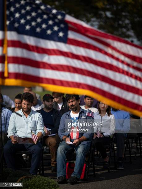 Immigrants wait to take the Oath of Citizenship during a naturalization ceremony at Liberty State Park October 2 2018 in Jersey City New Jersey 35...