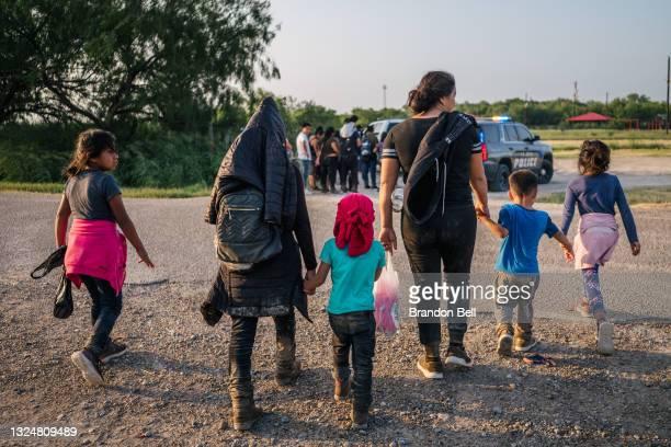Immigrants walk towards border patrol after crossing the Rio Grande into the U.S. On June 21, 2021 in La Joya, Texas. A surge of mostly Central...