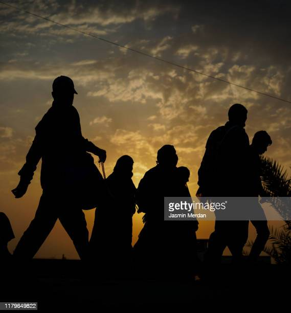immigrants walking for hope in better future - emigration and immigration stock pictures, royalty-free photos & images