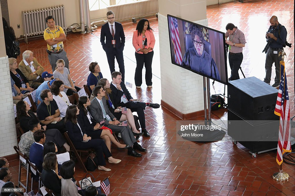 Immigrants watch as U.S. Supreme Court Associate Justice Sonia Sotomayor gives a taped address at a naturalization ceremony on Ellis Island on September 16, 2016 in New York City. The ceremony marked U.S. Constitution and Citizenship Day, which is September 17. According to U.S. Citizenship and Immigration Services (USCIS), some 38,000 people nationwide are becoming American citizens in 240 ceremonies nationwide this week, the most of any period in 2016.