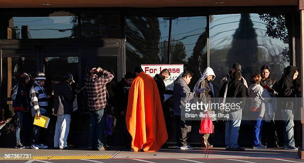 Immigrants without legal status line up to apply for California driver licenses at DMV offices January 2 2015 in Granada Hills