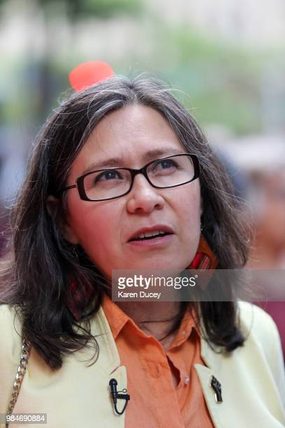 Immigration activist Maru MoraVillalpando holds a rally prior to her second deportation hearing outside the Seattle Immigration Court on June 26 2018...