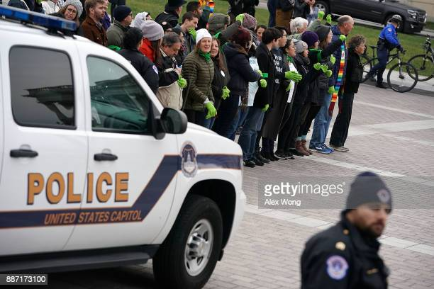 Immigration activists are arrested by US Capitol Police as they participate in a civil disobedience during a protest on the ground of the US Capitol...