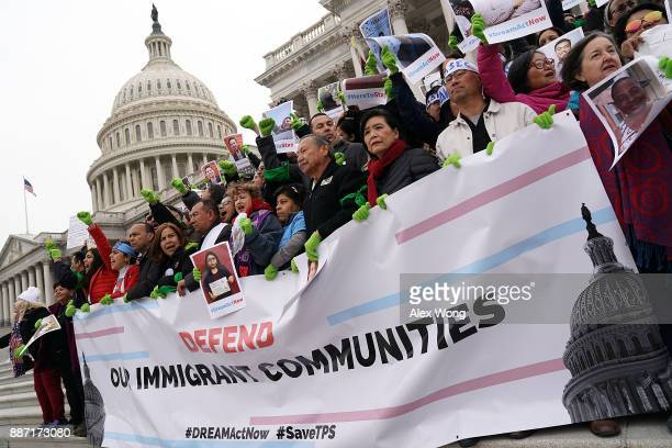 Immigration activists including US Rep Judy Chu and Rep Luis Gutierrez stage a protest on the steps of the US Capitol December 6 2017 in Washington...