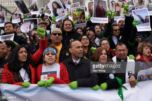 Immigration activists including US Rep Luis Gutierrez stage a protest on the steps of the US Capitol December 6 2017 in Washington DC Activists urged...