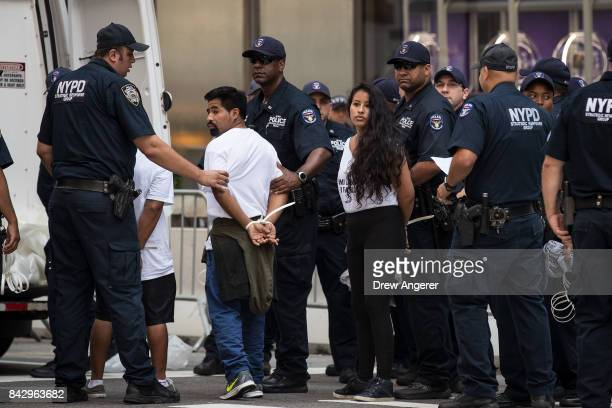 Immigration activists protesting the Trump administration's decision on the Deferred Action for Childhood Arrivals are arrested by New York City...