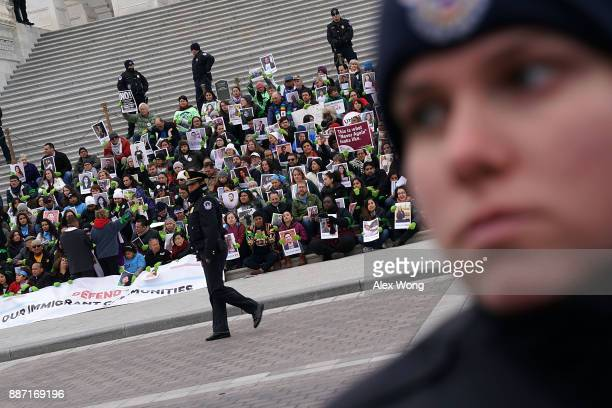Immigration activists stage a protest on the steps of the US Capitol December 6 2017 in Washington DC Activists urged the Congress to pass a clean...