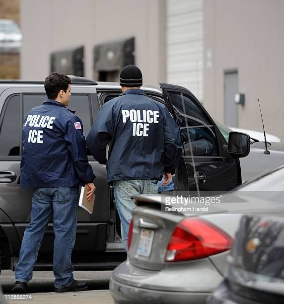 US Immigration and Customs Enforcement agents leave the Yamato Engine Specialist plant in Bellingham Washington after raiding the plant for illegal...