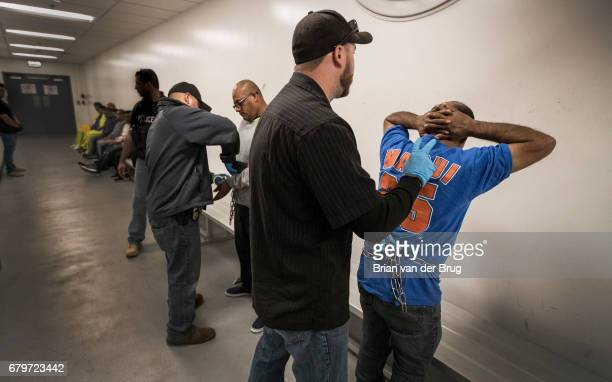 LOS ANGELES CALIF TUESDAY APRIL 18 2017 Immigration and Customs Enforcement agents search Esteban Amigon center left and Sergio Rodriguez right as...