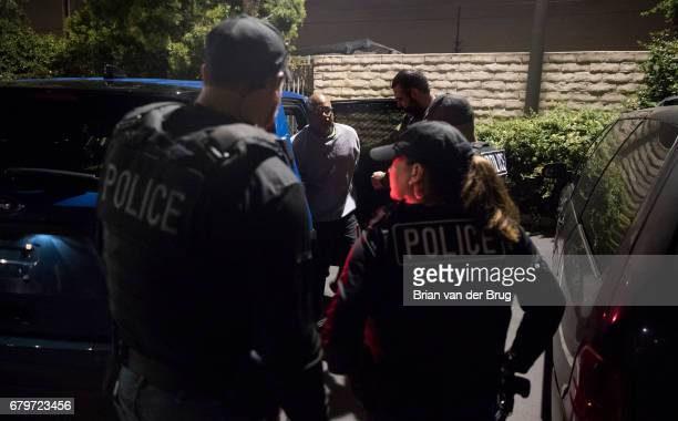 COMPTON CALIF TUESDAY APRIL 18 2017 Immigration and Customs Enforcement agents transfer Mexican national Esteban Amigon for transportation to...