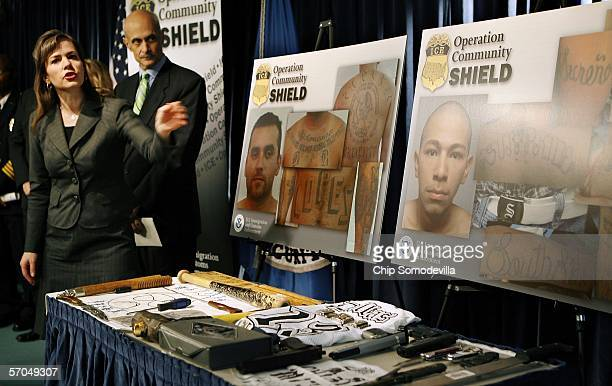 Immigration and Customs Enforcement Assistant Secretary Julie Myers and Homeland Security Secretary Michael Chertoff point at photographs of some of...