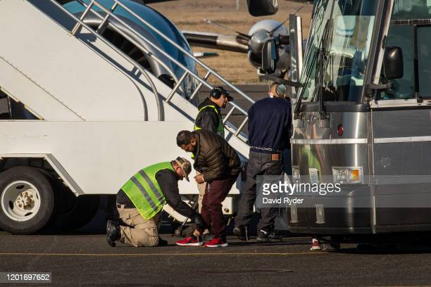 Immigration and Customs Enforcement detainee is searched before boarding a Swift Air charter flight at McCormick Air Center on February 18, 2020 in...