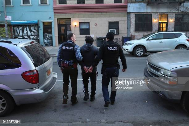 Immigration and Customs Enforcement , officers arrest an undocumented Mexican immigrant during a raid in the Bushwick neighborhood of Brooklyn on...