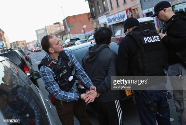 S Immigration and Customs Enforcement officers arrest an undocumented Mexican immigrant during a raid in the Bushwick neighborhood of Brooklyn on...
