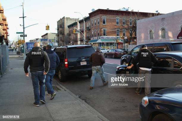 S Immigration and Customs Enforcement officers depart after an operation to arrest an wanted undocumented immigrant on April 11 2018 in the Brooklyn...