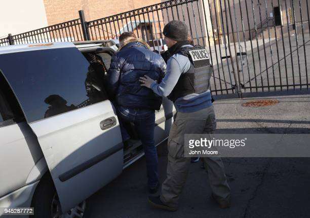 S Immigration and Customs Enforcement officers load a Polish immigrant into an unmarked car after staging a raid on April 11 2018 in the Brooklyn...