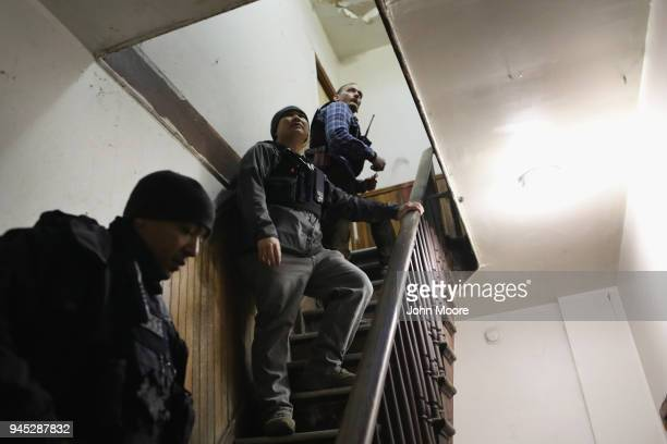 S Immigration and Customs Enforcement officers look to arrest an undocumented immigrant during an operation in the Bushwick neighborhood of Brooklyn...