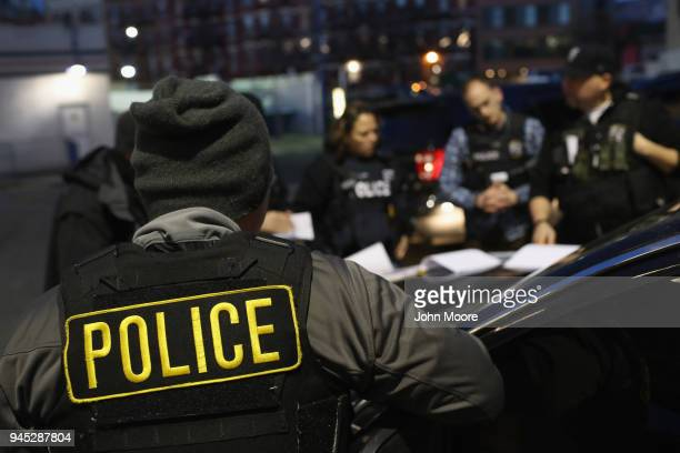 S Immigration and Customs Enforcement officers prepare for morning raids to arrest undocumented immigrants on April 11 2018 in New York City ICE...