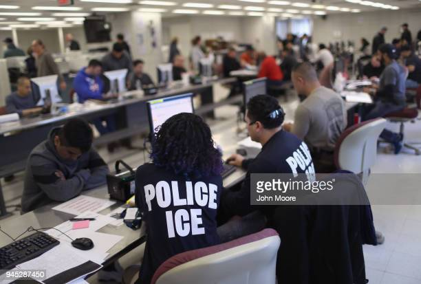 S Immigration and Customs Enforcement officers process detained undocumented immigrants on April 11 2018 at the US Federal Building in lower...